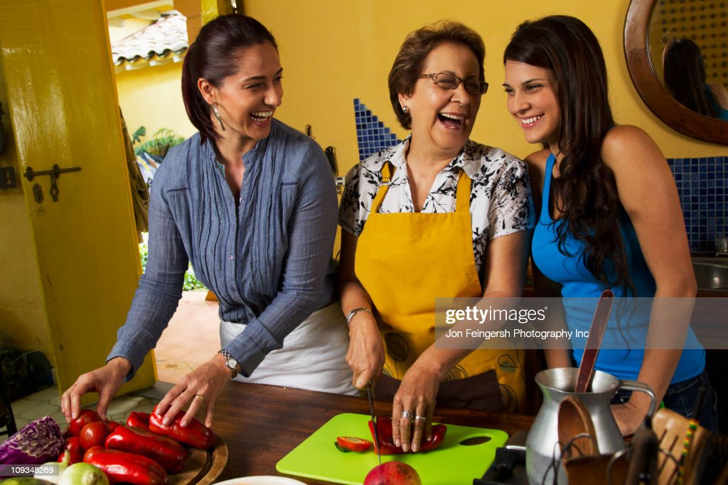 Hispanic family cooking together : Stock Photo