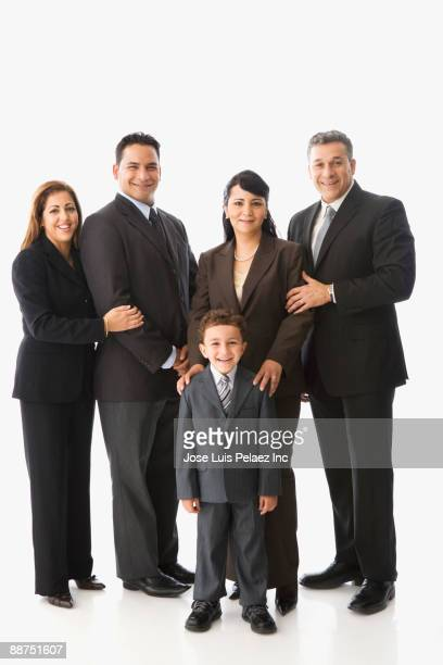 Hispanic family dressed in business suits