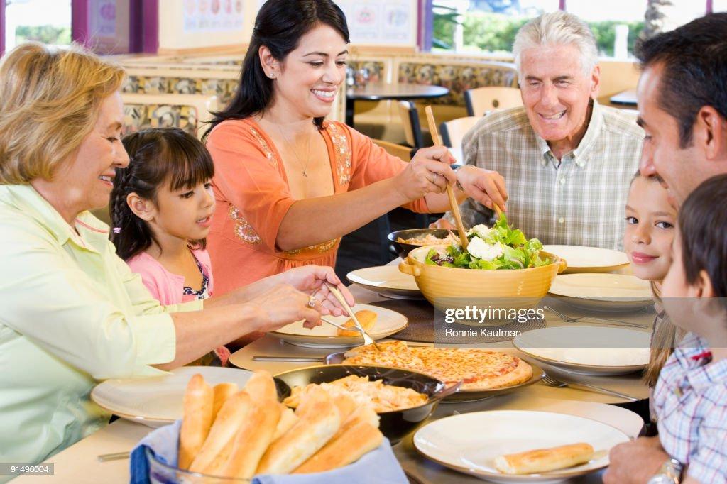 Hispanic Family Eating Dinner Together Stock Photo