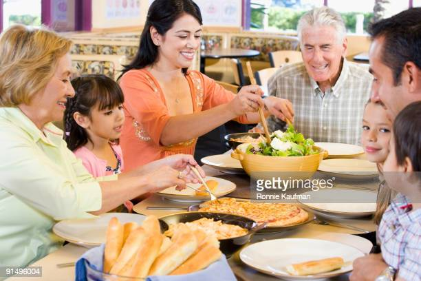Hispanic family eating dinner together