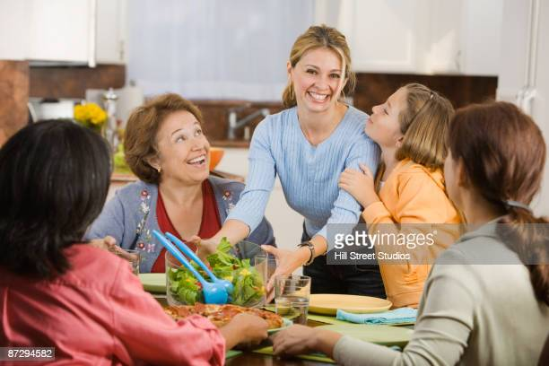 hispanic family eating in kitchen - filipino family dinner stock pictures, royalty-free photos & images