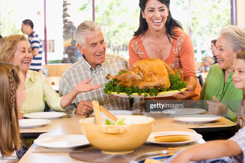 Hispanic Family Eating Thanksgiving Dinner Together Stock Photo