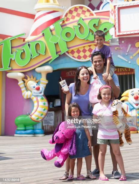 hispanic family enjoying amusement park - fun house stock pictures, royalty-free photos & images