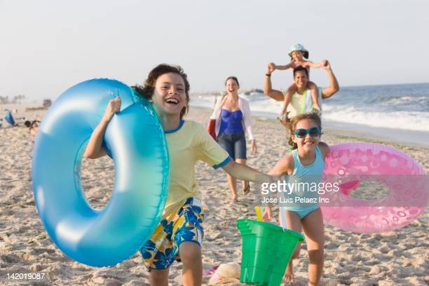 Hispanic family enjoying beach together