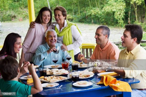 Hispanic family enjoying meal together
