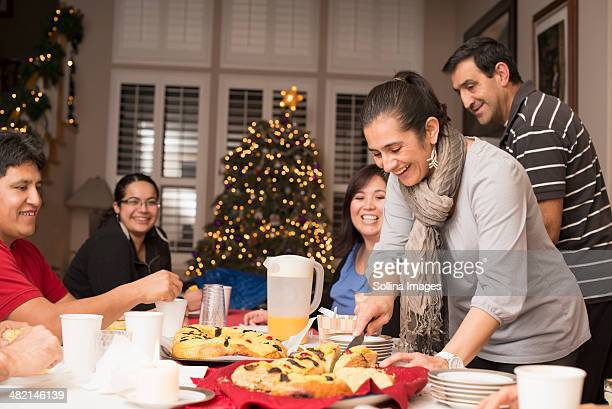 hispanic family enjoying traditional christmas dessert - mexican christmas stock photos and pictures