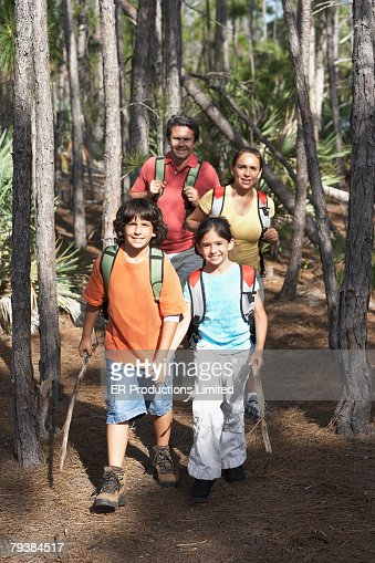 Hispanic Father And Son Hiking Stock Photo