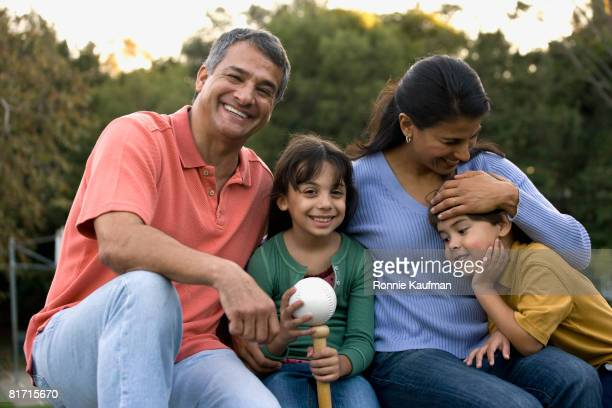 hispanic family hugging - baseball mom stock pictures, royalty-free photos & images