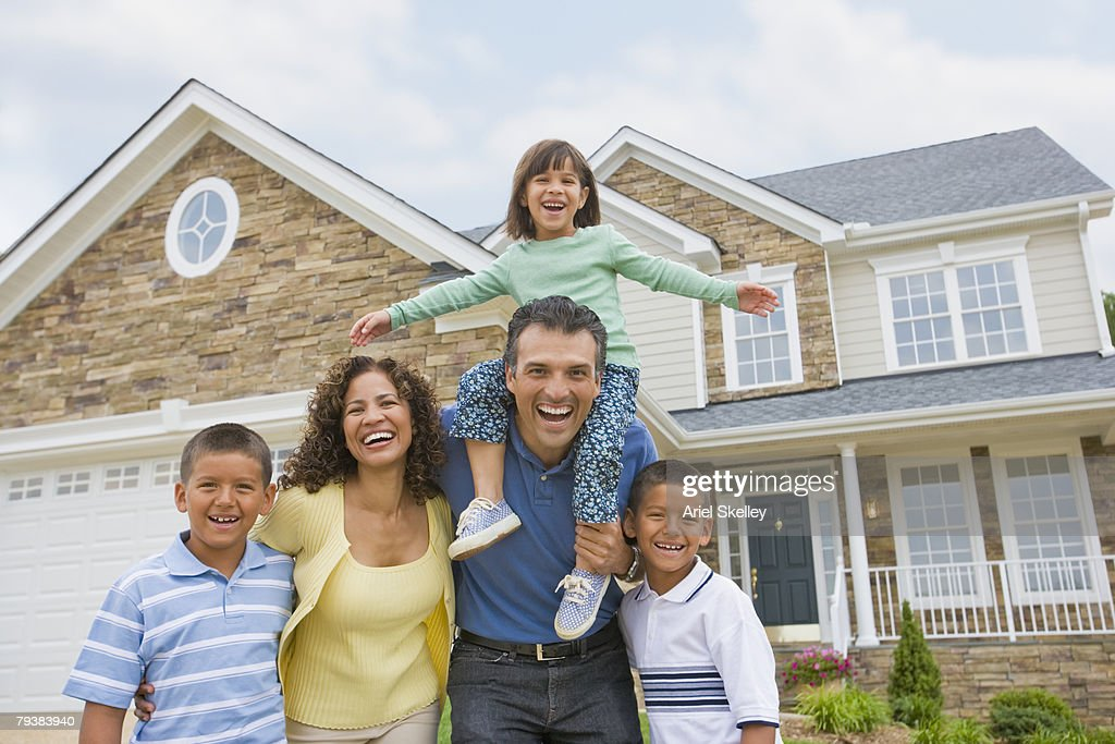 hispanic family in front of house stock photo getty images. Black Bedroom Furniture Sets. Home Design Ideas
