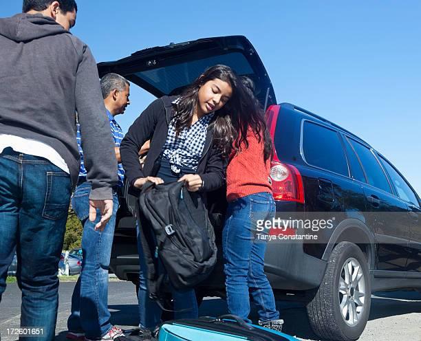 Hispanic family packing up car