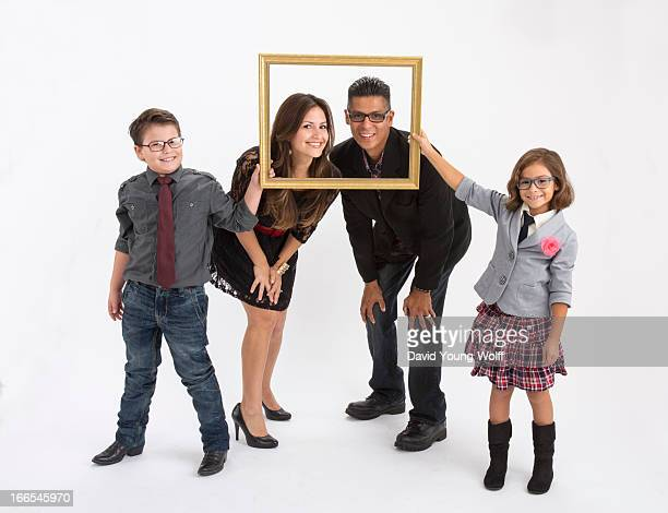 Hispanic family portrait, parents and two children