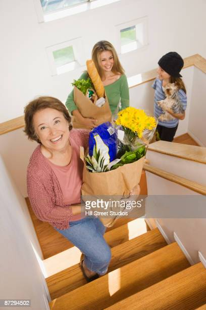 Hispanic family returning home with groceries