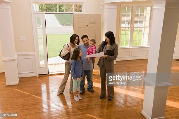 Hispanic family shopping for new house