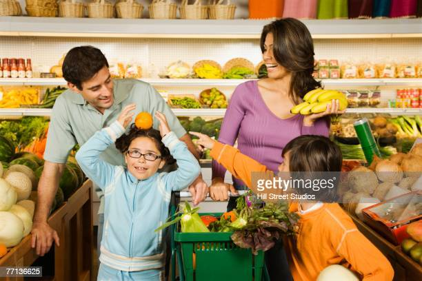 Hispanic family shopping in grocery store