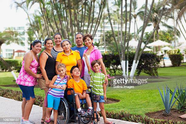 Hispanic family standing together outdoors