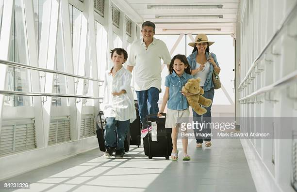 Hispanic family walking through airport