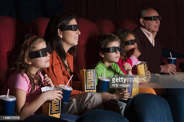 hispanic family watching 3d movie - 3d mom son stock photos and pictures