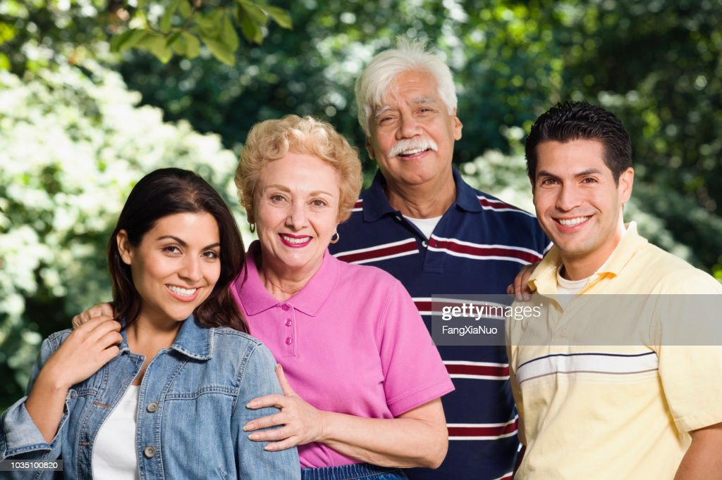 Hispanic family with adult children : Stock Photo