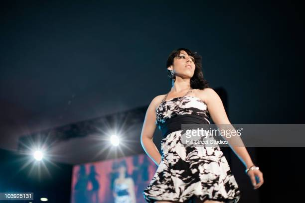 hispanic fashion model - striding stock pictures, royalty-free photos & images