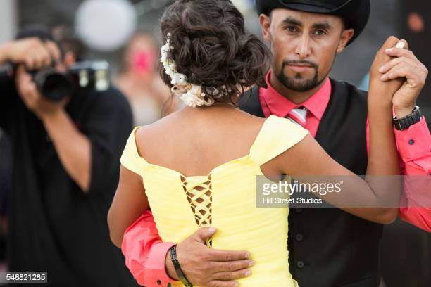 Hispanic father dancing with daughter at quinceanera