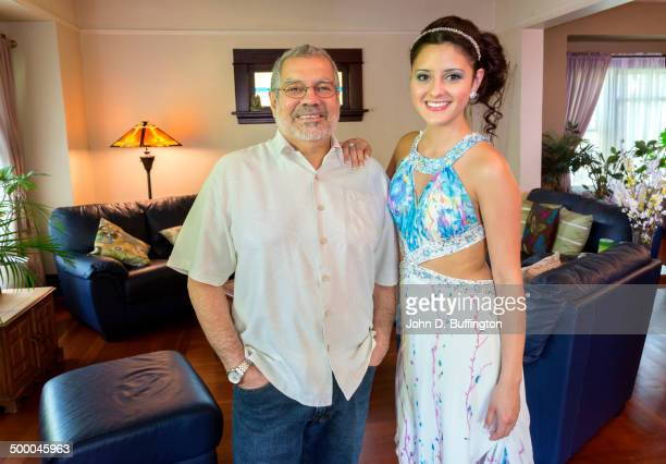Hispanic father smiling with daughter ready for prom