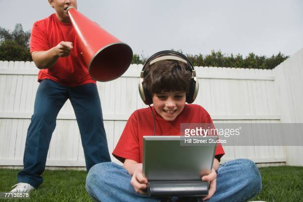 Hispanic father yelling at son playing video games