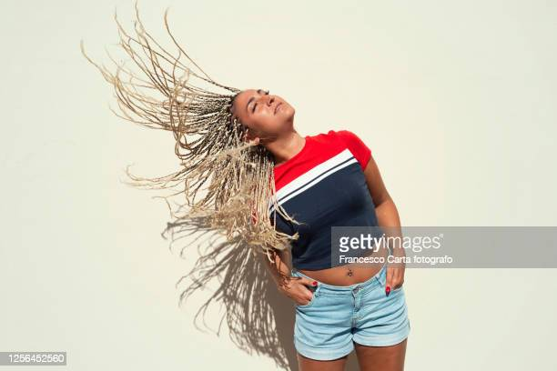 hispanic female flicking hair - flowing stock pictures, royalty-free photos & images