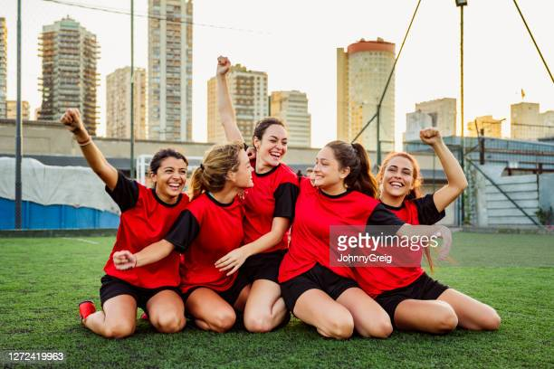 hispanic female footballers in 20s and 30s celebrating win - sports team stock pictures, royalty-free photos & images