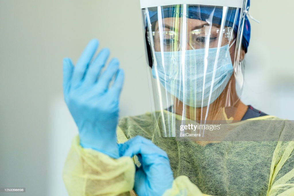 Hispanic female medical professional in Personal Protective Equipment : Stock Photo