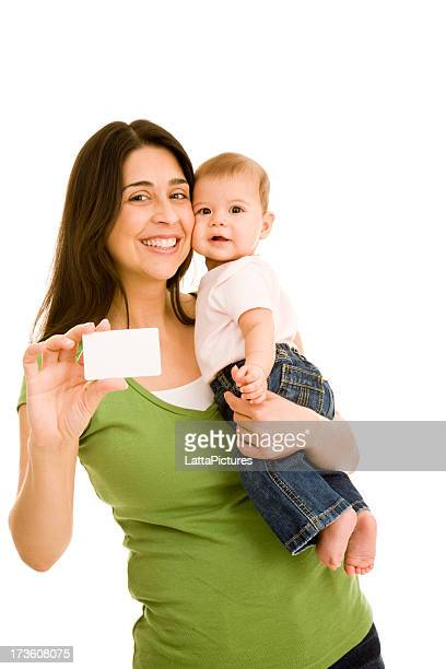 Hispanic female mother holding infant daughter and blank card