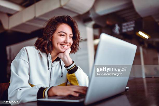 hispanic female studying on laptop - one person stock pictures, royalty-free photos & images