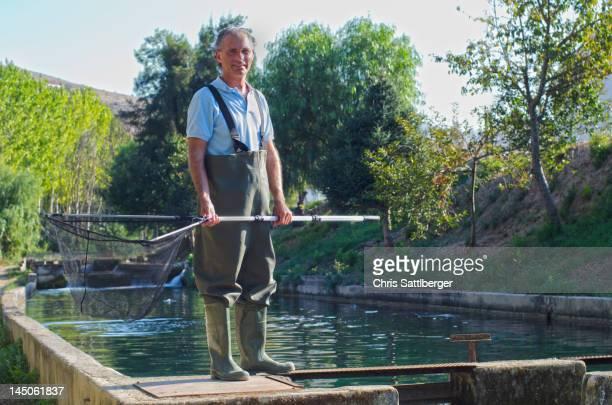 Hispanic fisherman holding net