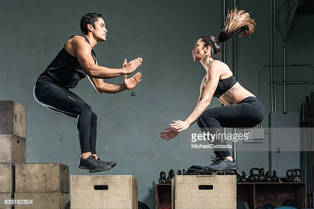 Hispanic Fitness Couple Working Out Together