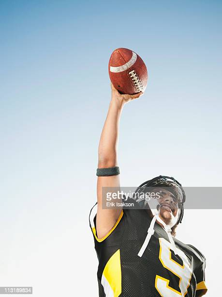 hispanic football player lifting football - safety american football player stock pictures, royalty-free photos & images