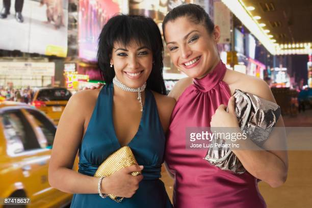 Hispanic friends dressed for night out