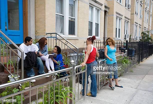 Hispanic friends on steps