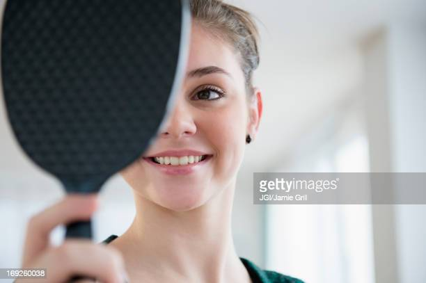 Hispanic girl admiring herself in mirror
