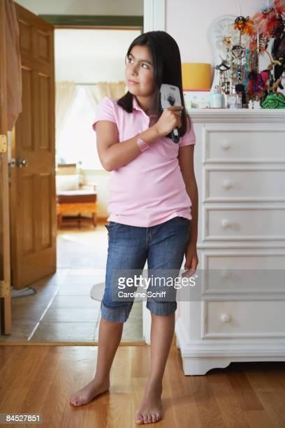 Hispanic girl brushing her hair