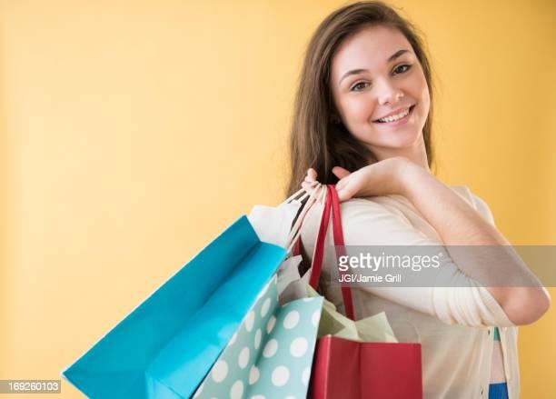 Hispanic girl carrying shopping bags