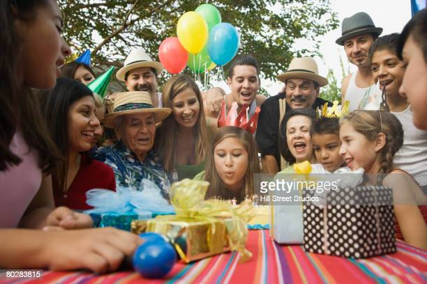 Hispanic girl celebrating birthday with family