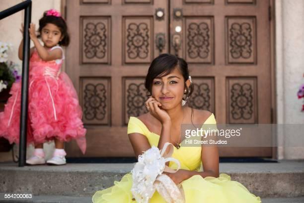 Hispanic girl celebrating quinceanera outside Catholic church