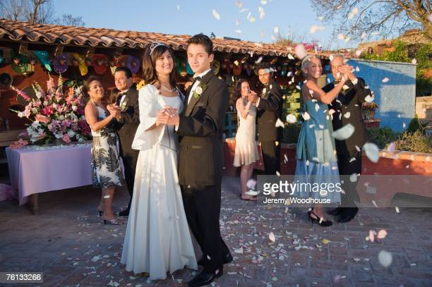 hispanic girl dancing with chamberlain at quinceanera - quinceanera stock pictures, royalty-free photos & images