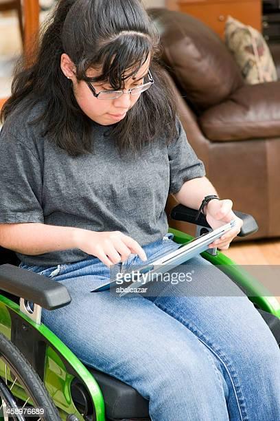 Hispanic girl holding an iPad2