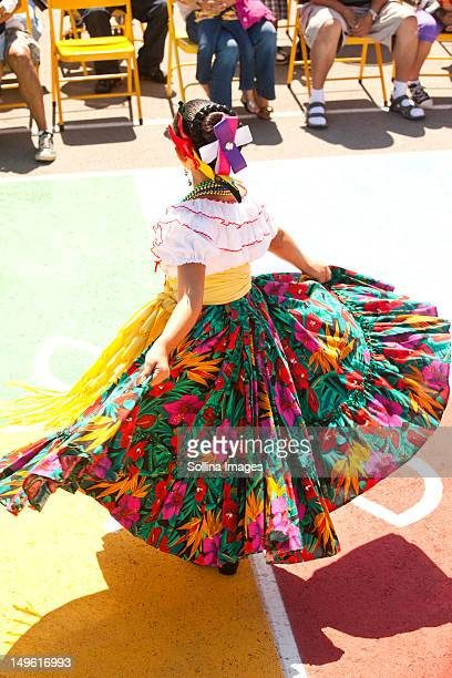 hispanic girl in costume dancing - traditional dancing stock photos and pictures
