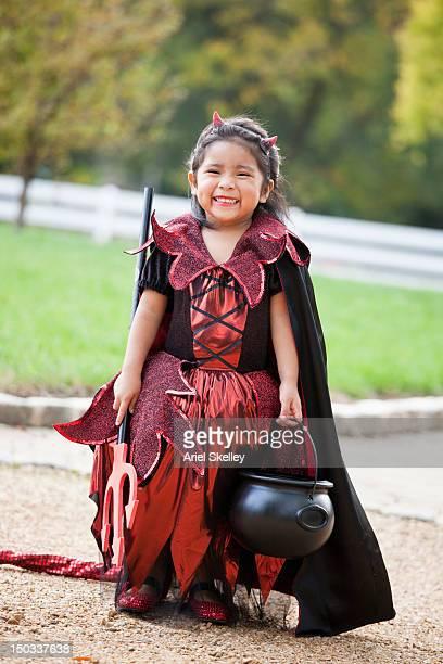 hispanic girl in halloween devil's costume - devil costume stock photos and pictures