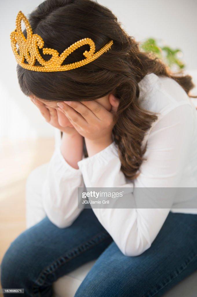 Hispanic girl in tiara crying : Stock Photo