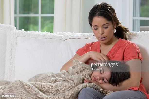 Hispanic girl lying on her mother's lap