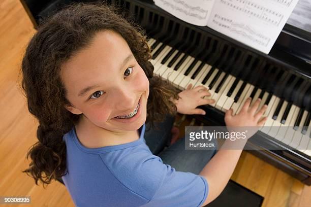 Hispanic girl playing a piano