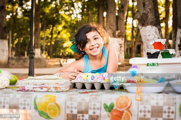 hispanic girl smiling with easter eggs - mexican picnic stock pictures, royalty-free photos & images