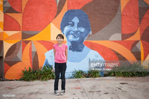 hispanic girl standing near mural - mural stock pictures, royalty-free photos & images